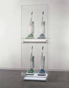 "Jeff Koons, ""New Hoover Convertibles Green, Blue, New Hoover Convertibles, Green, Blue Doubledecker,"" 1981–87, four vacuum cleaners, acrylic, and fluorescent lights. Whitney Museum of American Art, purchase with funds from The Sondra and Charles Gilman, Jr. Foundation, Inc., and the Painting and Sculpture Committee  89.30a-v. ©Jeff Koons"